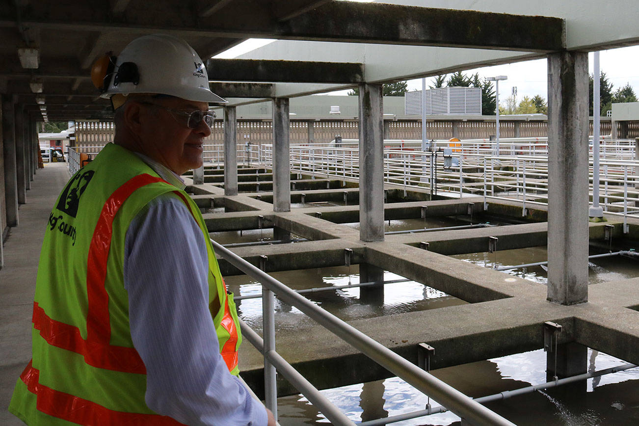 Jim Pitts stands on walkway overlooking filtration chambers at the King County South Treatment Plant in Renton. Aaron Kunkler/staff photo